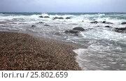 Купить «Морские волны на галечном пляже в ветреную погоду. Остров Родос. Греция», видеоролик № 25802659, снято 9 октября 2015 г. (c) Виктория Катьянова / Фотобанк Лори