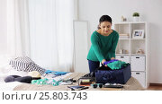 Купить «woman packing travel bag at home or hotel room», видеоролик № 25803743, снято 19 января 2017 г. (c) Syda Productions / Фотобанк Лори
