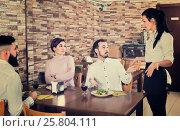 Купить «Unpleased client talking with manager in restaurant», фото № 25804111, снято 17 января 2017 г. (c) Яков Филимонов / Фотобанк Лори