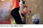 Купить «young woman exercising at indoor climbing gym wall», видеоролик № 25804555, снято 2 марта 2017 г. (c) Syda Productions / Фотобанк Лори