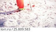 Купить «Low section of skier on snowy field», фото № 25809583, снято 18 августа 2019 г. (c) Wavebreak Media / Фотобанк Лори