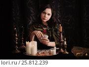 Купить «Young woman with divination cards in room», фото № 25812239, снято 5 марта 2017 г. (c) Майя Крученкова / Фотобанк Лори