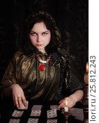 Купить «Young woman with divination cards in room», фото № 25812243, снято 5 марта 2017 г. (c) Майя Крученкова / Фотобанк Лори