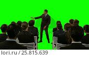 Купить «Businessman using futuristic digital screen while giving presentation to colleagues», видеоролик № 25815639, снято 23 ноября 2019 г. (c) Wavebreak Media / Фотобанк Лори