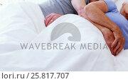 Senior couple sleeping on bed in bedroom. Стоковое видео, агентство Wavebreak Media / Фотобанк Лори