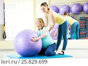 Купить «pregnant woman doing fitness ball exercise with coach», фото № 25829699, снято 3 марта 2017 г. (c) Дмитрий Калиновский / Фотобанк Лори