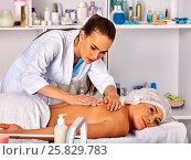 Купить «Massage therapy deals. Woman therapist making manual therapy back.», фото № 25829783, снято 6 октября 2015 г. (c) Gennadiy Poznyakov / Фотобанк Лори