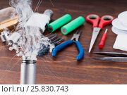 Купить «Check RDA. Set to vape. Tools, cotton, liquid, RDA, RTA.», фото № 25830743, снято 17 января 2017 г. (c) Сергей Лабутин / Фотобанк Лори