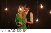 Young man gently strokes his girlfriend. Стоковое видео, видеограф Илья Насакин / Фотобанк Лори
