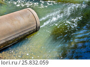 Water flows from the pipe into the river. Стоковое фото, фотограф Олеся Новицкая / Фотобанк Лори