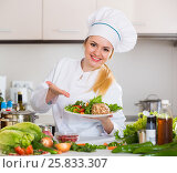 Female cook arranging herbs decoration on plate with salad. Стоковое фото, фотограф Яков Филимонов / Фотобанк Лори