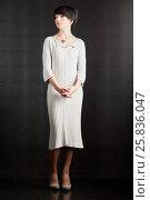 Купить «Full-length portrait of dark-haired woman in white knitted dress», фото № 25836047, снято 29 марта 2015 г. (c) Losevsky Pavel / Фотобанк Лори