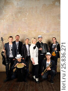 Купить «Music brass band of eight young people in white and black clothes pose in studio», фото № 25836271, снято 9 февраля 2016 г. (c) Losevsky Pavel / Фотобанк Лори