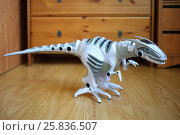 Interactive robot dinosaur standing on the floor in the room. Стоковое фото, фотограф Losevsky Pavel / Фотобанк Лори