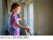 Купить «Young girl standing inside train and pensively looking out window», фото № 25836583, снято 5 августа 2014 г. (c) Losevsky Pavel / Фотобанк Лори