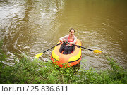 Купить «Woman with oars and action camera in a rubber boat near the shore, top view», фото № 25836611, снято 24 июля 2015 г. (c) Losevsky Pavel / Фотобанк Лори