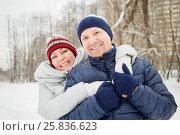 Купить «Half-length portrait of embracing happy smiling man and woman in winter park», фото № 25836623, снято 25 января 2015 г. (c) Losevsky Pavel / Фотобанк Лори
