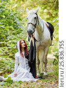 Купить «Young woman in black and white dress sits near horse in park», фото № 25836755, снято 20 сентября 2015 г. (c) Losevsky Pavel / Фотобанк Лори
