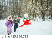 Купить «Little boy and girl stand looking at stuffed dummy Maslenitsa that sits on snowbank in winter park», фото № 25836795, снято 25 января 2015 г. (c) Losevsky Pavel / Фотобанк Лори