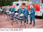 MOSCOW, RUSSIA - AUG 20, 2016: Teams of firefighters stand next to the fire trucks and tables with clothes during the Moscow City Championship of combat deployment in Luzhniki, фото № 25836871, снято 20 августа 2016 г. (c) Losevsky Pavel / Фотобанк Лори