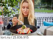 Купить «Woman eats dessert with icecream and fruits in cafe outdoor», фото № 25836915, снято 20 августа 2016 г. (c) Losevsky Pavel / Фотобанк Лори