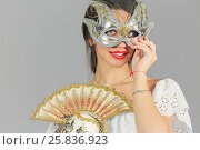 Купить «Half-lengthl portrait of young woman in carnival mask, holding another mask in hand, look at us, close-up», фото № 25836923, снято 14 декабря 2014 г. (c) Losevsky Pavel / Фотобанк Лори
