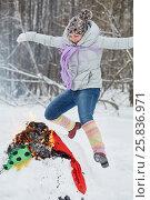 Купить «Woman jumps over burning stuffed Maslenitsa in winter park», фото № 25836971, снято 25 января 2015 г. (c) Losevsky Pavel / Фотобанк Лори