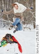 Купить «Teenage girl jumps over burning stuffed Maslenitsa in winter park», фото № 25836979, снято 25 января 2015 г. (c) Losevsky Pavel / Фотобанк Лори