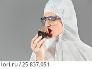 Купить «Half-length portrait of woman biting piece of tasty chocolate cake and looking on cake, on gray background», фото № 25837051, снято 14 декабря 2014 г. (c) Losevsky Pavel / Фотобанк Лори