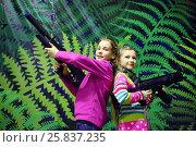 Купить «Two girls pose together with big machine guns near wall, lasertag game», фото № 25837235, снято 30 января 2015 г. (c) Losevsky Pavel / Фотобанк Лори