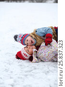 Купить «Mother and her cute little son lies on ice and laugh in winter day», фото № 25837323, снято 31 января 2015 г. (c) Losevsky Pavel / Фотобанк Лори