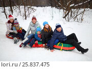 Купить «Six people on snow tubes down hill at winter day, focus on father and girl teenager», фото № 25837475, снято 31 января 2015 г. (c) Losevsky Pavel / Фотобанк Лори