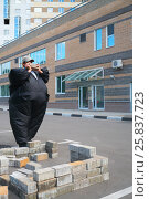 Купить «Boy in black suit inflatable building brick wall in parking area near house», фото № 25837723, снято 25 июня 2014 г. (c) Losevsky Pavel / Фотобанк Лори