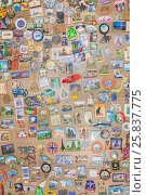 Купить «MOSCOW - FEB 10, 2015: Souvenir magnets from different cities and countries are on table, above view», фото № 25837775, снято 10 февраля 2015 г. (c) Losevsky Pavel / Фотобанк Лори