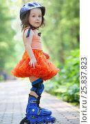 Купить «Little girl in skirt and helmet roller skates in garden at summer day», фото № 25837823, снято 24 июня 2015 г. (c) Losevsky Pavel / Фотобанк Лори