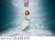 Купить «Smiling young woman in white dress poses in swimming pool underwater», фото № 25838015, снято 14 мая 2016 г. (c) Losevsky Pavel / Фотобанк Лори
