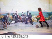 Купить «MOSCOW, RUSSIA - MAR 24, 2015: Woman (with model release) plays football in Optical Illusions Museum at VDNKH», фото № 25838243, снято 24 марта 2015 г. (c) Losevsky Pavel / Фотобанк Лори