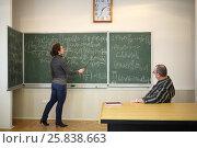 Купить «Woman speaks with pointer near blackboard with formulas and man listen to her in school classroom», фото № 25838663, снято 7 апреля 2016 г. (c) Losevsky Pavel / Фотобанк Лори