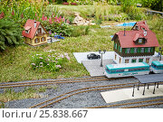 Купить «MOSCOW, RUSSIA - JUN 26, 2015: Layout of old railway station with rails, trains and buildings in Sokolniki park during festival Gardens and People», фото № 25838667, снято 26 июня 2015 г. (c) Losevsky Pavel / Фотобанк Лори