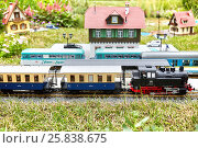Купить «MOSCOW, RUSSIA - JUN 26, 2015: Layout of old railway station with rails, trains and buildings in Sokolniki park during festival Gardens and People», фото № 25838675, снято 26 июня 2015 г. (c) Losevsky Pavel / Фотобанк Лори