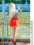 Купить «Blonde pretty woman in striped t-shirt sits near big window on ship, back view», фото № 25838835, снято 25 августа 2015 г. (c) Losevsky Pavel / Фотобанк Лори