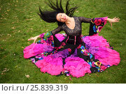 Купить «Young woman in beautiful skirt zingara poses on green lawn outdoor», фото № 25839319, снято 15 октября 2015 г. (c) Losevsky Pavel / Фотобанк Лори