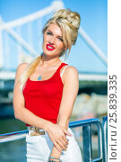 Купить «Beautiful blonde woman poses on deck of ship at river in summer city», фото № 25839335, снято 25 августа 2015 г. (c) Losevsky Pavel / Фотобанк Лори
