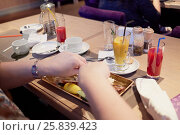 Купить «Female hands above plate with food on table in cafe», фото № 25839423, снято 28 декабря 2014 г. (c) Losevsky Pavel / Фотобанк Лори