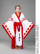 Купить «Girl in traditional Japanese costume and makeup standing studio shot», фото № 25839427, снято 17 ноября 2014 г. (c) Losevsky Pavel / Фотобанк Лори