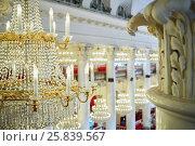 Купить «Closeup chandelier with electrical candles in the hall with columns», фото № 25839567, снято 23 апреля 2016 г. (c) Losevsky Pavel / Фотобанк Лори