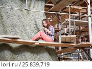 Купить «RUSSIA, MOSCOW - MAY 28, 2015: Female sculptor at scuffolding aound clay sculpture to St. Prince Vladimir during manufacture it in the workshop of Salavat Shcherbakov.», фото № 25839719, снято 28 мая 2015 г. (c) Losevsky Pavel / Фотобанк Лори