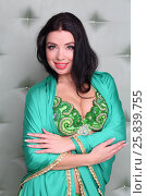 Купить «Beautiful woman in green oriental costume with a cape on the shoulders», фото № 25839755, снято 22 ноября 2014 г. (c) Losevsky Pavel / Фотобанк Лори