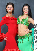 Купить «Portrait of two beautiful women in a green and red costumes», фото № 25839763, снято 22 ноября 2014 г. (c) Losevsky Pavel / Фотобанк Лори