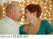 Купить «A man and a woman closing eyes touch noses in the room with garland», фото № 25839951, снято 22 февраля 2015 г. (c) Losevsky Pavel / Фотобанк Лори